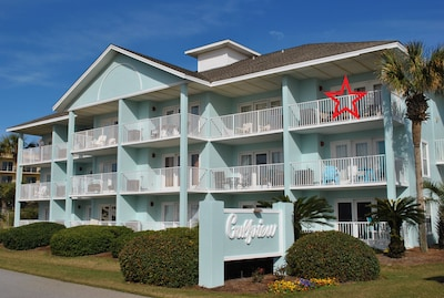 Corner unit in front building with view of beach.
