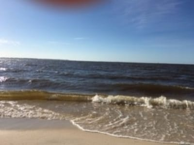 One minute walk to the beach.10 minutes walk  into downtow. 5 miles from I-10.