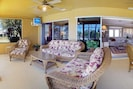 Enjoy indoor living on the covered Lanai next to pool . Enjoy TV here also.