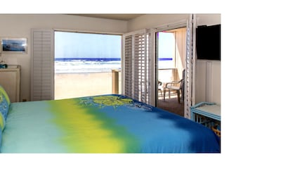 Master  Bedroom with ocean view with bluue and yellow bedspread