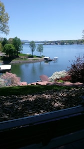 Lakefront view from patio and porch swing