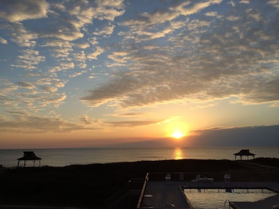 Sunrise over the Atlantic from your own private beach front balcony.