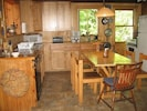 Easy to use, fully equipped kitchen with table; another table is in dining room.