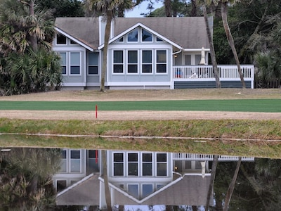 House from the golf course side.  Shows newly enlarged deck.