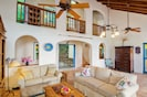 Great room with high vaulted ceilings and access to back courtyard.
