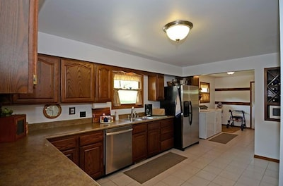 Large kitchen with stainless appliances.