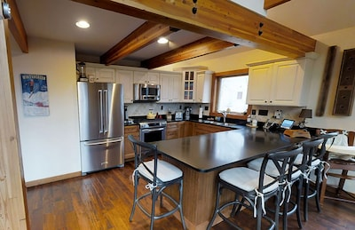 Gourmet Kitchen with granite counter tops and all the finest accessories