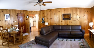 Gorgeous knotty pine living room with leather sectional sofa sleeper