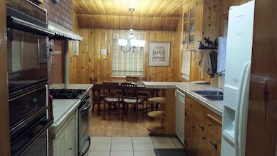 Warm, cozy kitchen with two ovens.
