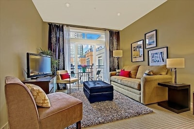 Living Room with high ceilings, and very comfortable sleeper sofa