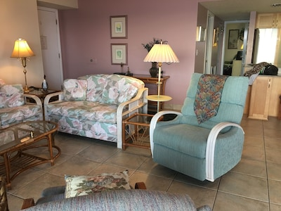 Living room with sofa, love seat, and two recliners
