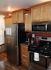 Full size refrigerator, stove/oven, and microwave.
