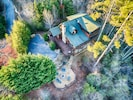 Aerial view of house and fire pit
