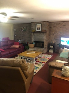 Living area, 2sofas, 2 recliners, WiFi, local television channels.