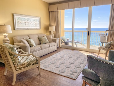 Living room with expansive gulf views and sofa bed