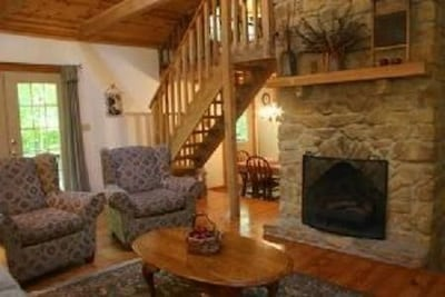 Fireplace in Living Room with Stairs to Bedroom