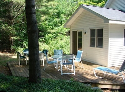 House #1,  Cedar deck connects dining area and M/Br.  Dinner for 8, sunny all d