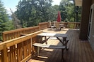The deck offers plenty of sitting and gathering space.