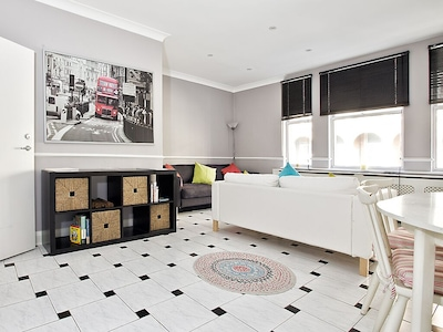Lovely black & white tiled floors and large picture windows!