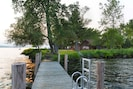 View of the house in summer, looking north from the front dock over Cayuga Lake