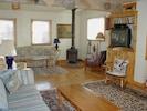 Large living room w/ woodstove, sat-TV, DVD player