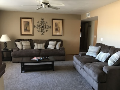 Living room with a 46 in LED TV.