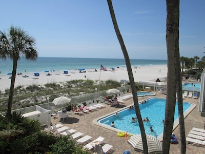 View of the pool, hot tub and beach