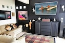 """55""""  TV and local art in your inside living area plus 2 recliners for TV viewing"""