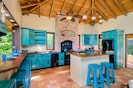 The gourmet kitchen is spacious with a wet bar and wonderfully casual dining