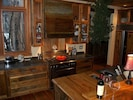 Reclaimed barnwood kitchen with Dacor 6 burner convection oven