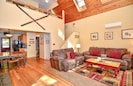 Main living area-open floor plan w/ real fireplace & 2-story cathedral ceilings!