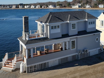 The Boathouse is west facing and is perched directly alongside the water.