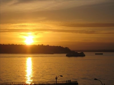 Sunset; ferry boat views await you from the living/dining room and bedroom!