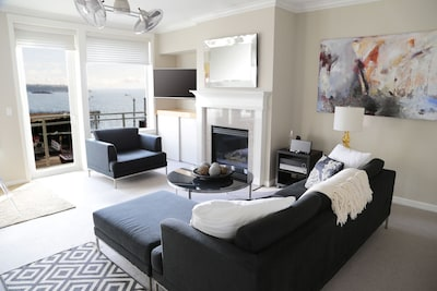 Great room w/ gas fireplace, new smart TV,  comfortable seating & fabulous vie