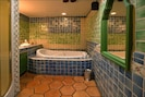 Full view of colorful, traditional bathroom.