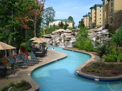 300'heated lazy river that flows around the tropical island with/rocks/waterfall