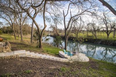 backyard limestone deack and river view
