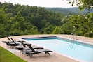 Heated pool with stunning lake and mountain views.