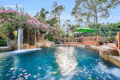 Lagoon Resort Spa/Pool/Slide. In Pool table-sitting area. View sitting deck area