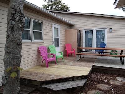 Back Deck has plenty of seating, outside shower. RandyAndDonnasBeachHouse