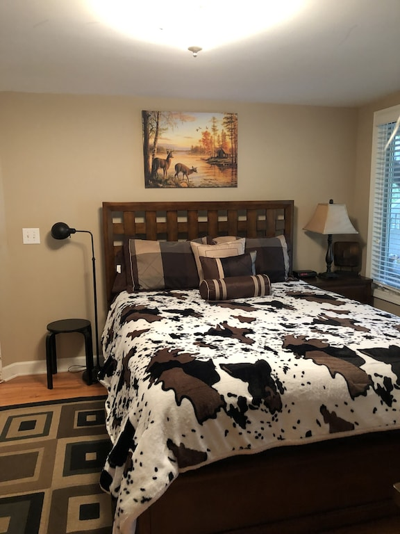 2nd Suite with queen bed, HDTV, lake views and private access to patio