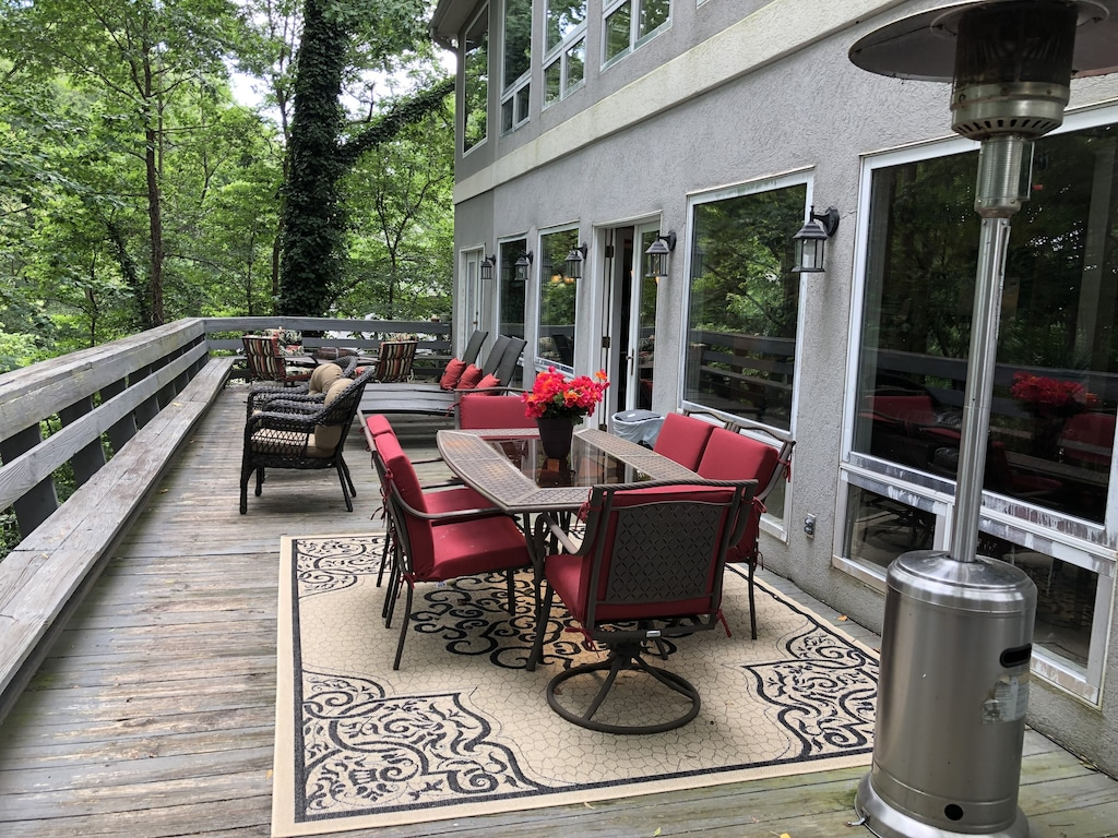 Large Deck with Lounges, BBQ, Fire Pit, and outside stairs to walk to the lake