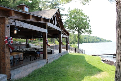 Outdoor pavilion and firepit area with 70' dock for your boats!!