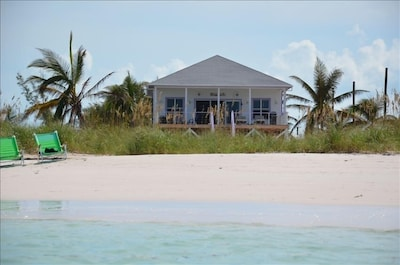 A view of Kiss a Fish Beach cottage taken right from the water.