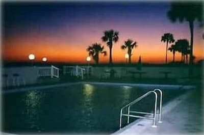 Pool with beautiful sunset from outside patio