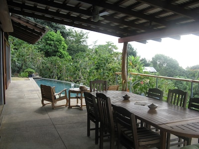 West saving deck with eating area and 40 foot lap pool
