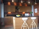 Kitchen with custom lighting fixtures made from copper plumbing pipes and parts