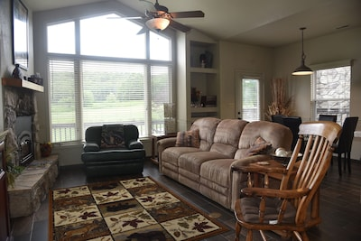 Living room w/view of golf course.  Sofa sides recline to almost horizontal