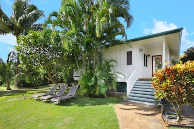 "Enter the front porch and front door into modernized ""Old Hawaii""."