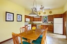 Spacious dining area and kitchen with granite countertops